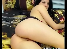 Brunette playing nigh her ass