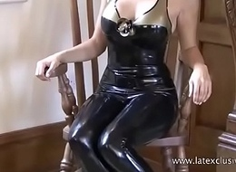 Black spandex dress and talisman agitate on posing softcore solo model Alyss in pvc rub