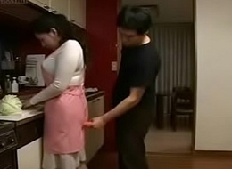 Japanese Wife and Juvenile Schoolboy in Kitchen Divertissement